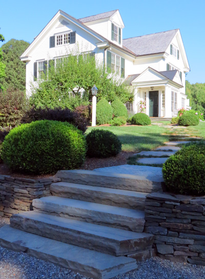 Steps can be built from a wide variety of materials to meet the needs of the landscape, while functioning safely. The staff at Millbrook Gardens Landscaping and Garden Center also specializes in the design and installation of natural rock paths that fit into a lawn area or between plantings. Photos by Curtis Schmidt.